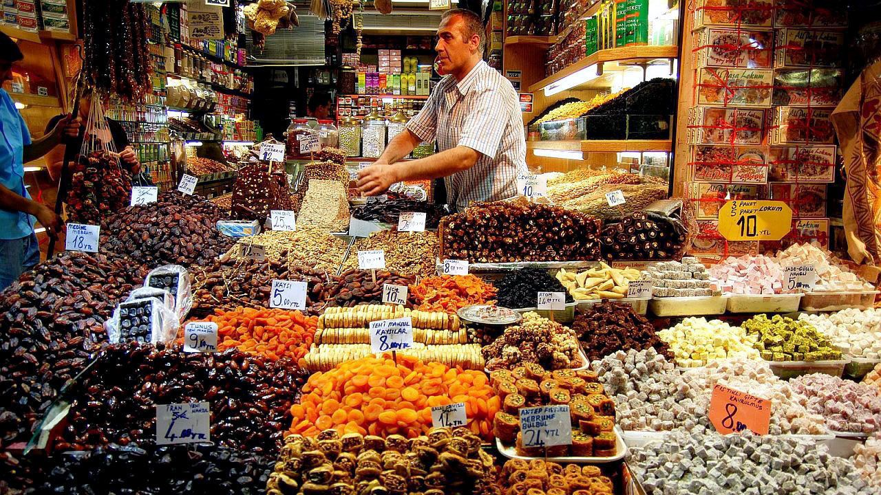 Man selling goods at a candy and sweets shop in Istanbul