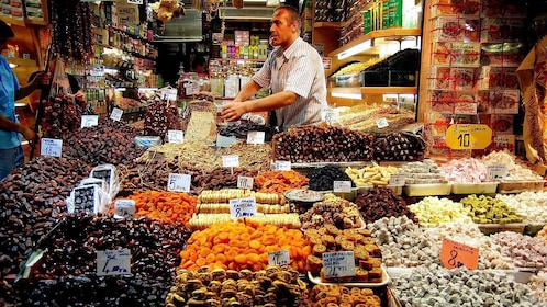 A man selling sweet goods at a local shop in Istanbul