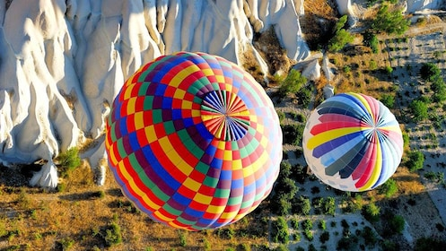 Close view of two hot air balloons above Cappadocia