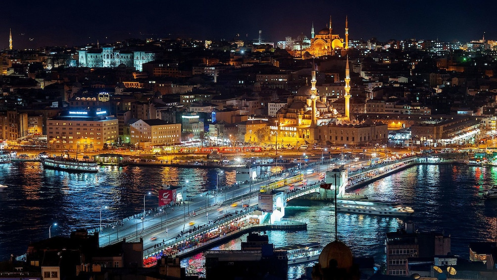 Show item 5 of 5. City of Istanbul lit with lights during the night time