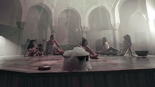 Group of guests relax inside the Cemberlitas Hamam in Istanbul