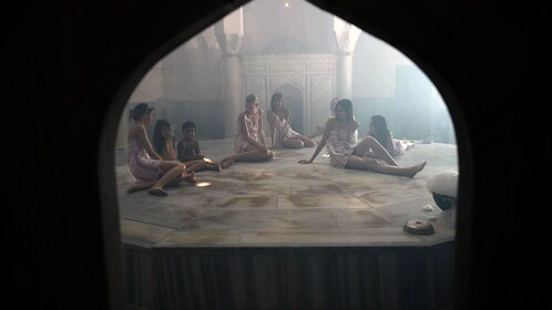 Guests relaxing at the Cemberlitas Hamam in Istanbul