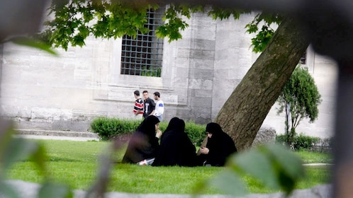 Group of people on the street and lawns of Istanbul