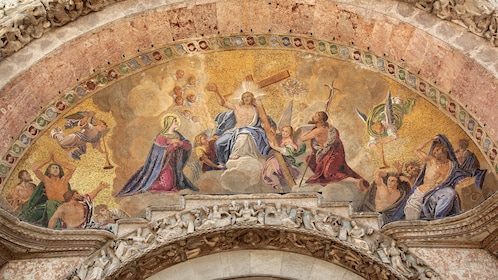 Mural of Jesus Mary and Joseph with angels