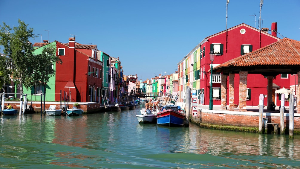 Show item 3 of 10. Canal with colorful buildings in Venice Italy