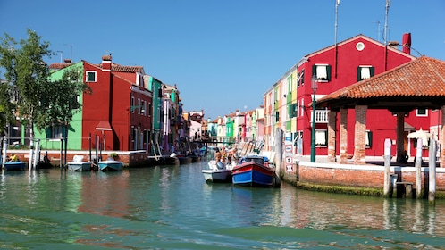 Canal with colorful buildings in Venice Italy