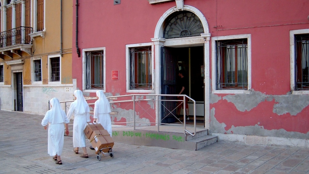 Nuns walking on the street in Venice Italy