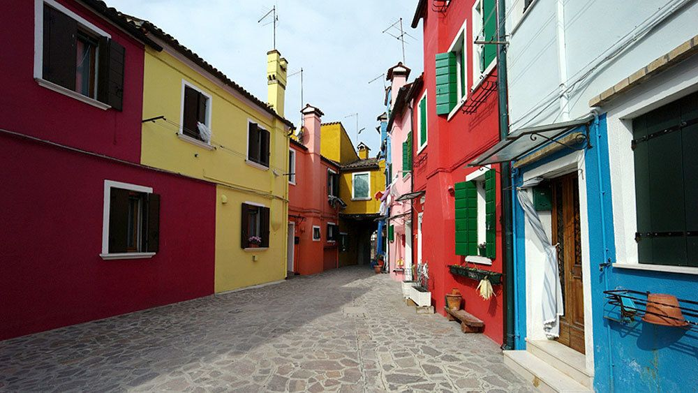 Colorful houses on the street of Venice Italy