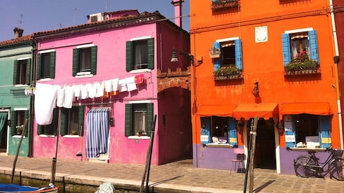 Colorful buildings along canal in Venice Italy