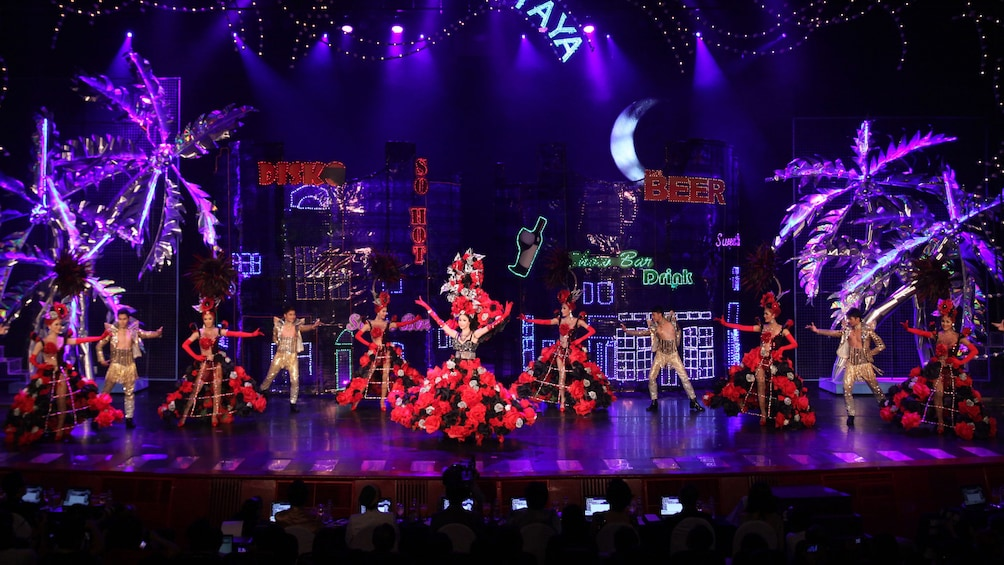 Show item 4 of 5. Performers in elaborate costumes at Tiffany's Cabaret Show in Pattaya