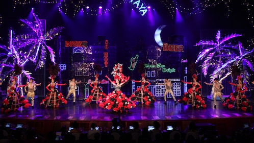 Performers in elaborate costumes at Tiffany's Cabaret Show in Pattaya