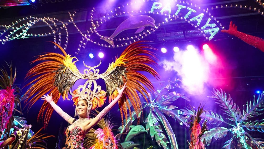 Show item 2 of 5. Performers in elaborate feathered head dresses performing at Tiffany's Cabaret Show in Pattaya
