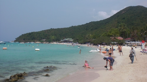 People relaxing on a beach at Koh Larn Coral Island
