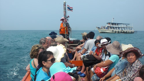 people on a boat to Koh Larn Coral Island
