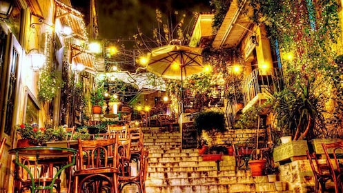 Dining on the Plaka stairs at night in Athens