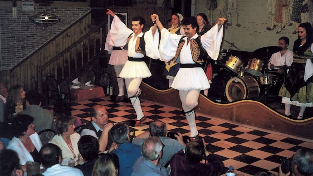 Charger l'élément 2 sur 10. Traditional Greek dancers onstage during a dinner show in Athens