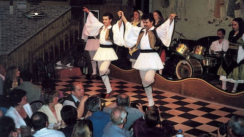 Traditional Greek dancers onstage during a dinner show in Athens