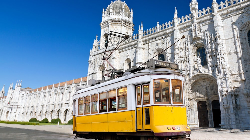 Show item 2 of 5. Trolley touring around Lisbon