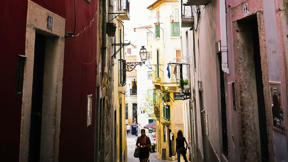 Show item 4 of 5. Narrow alleyway in Lisbon, Portugal