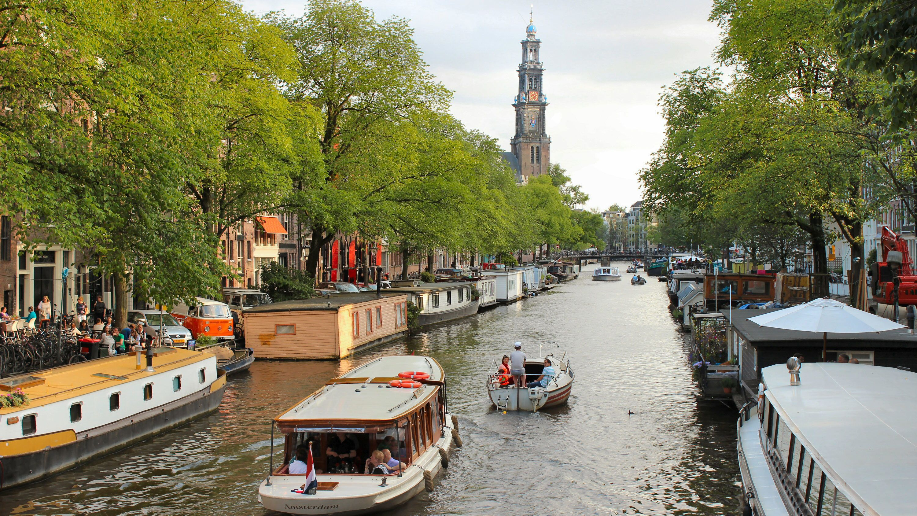 Cruise boat in canal in Amsterdam