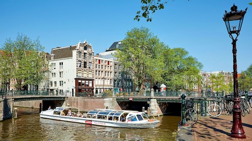 city view and cruise boat in amsterdam