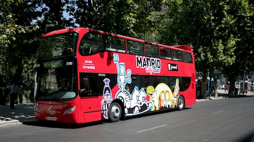 Red double-decker hop-on hop-off bus in Madrid