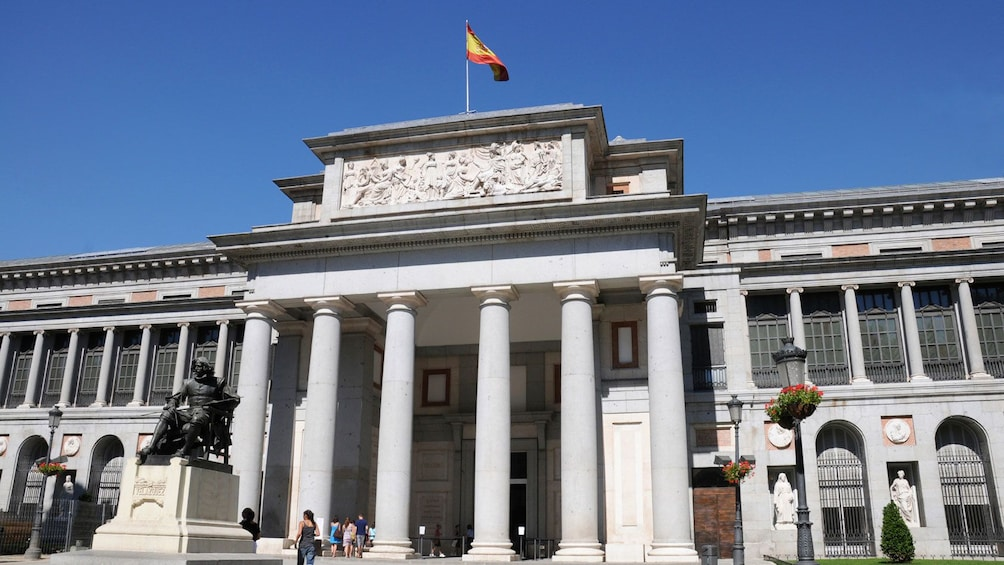 Image of people walking into the Museo del Prado the main Spanish national art museum in Madrid