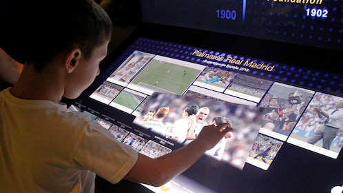 Boy looking at a display inside Bernabeu Stadium in Madrid