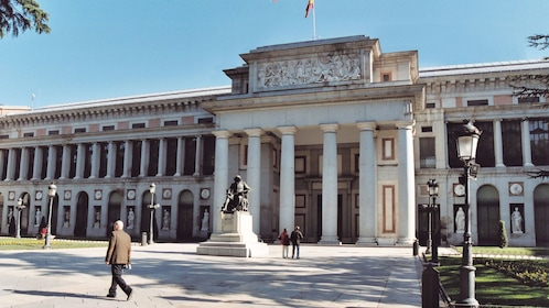 People walking by and into the Prado Museum in Madrid