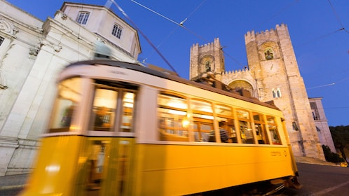 Trolley passing by a church in Lisbon