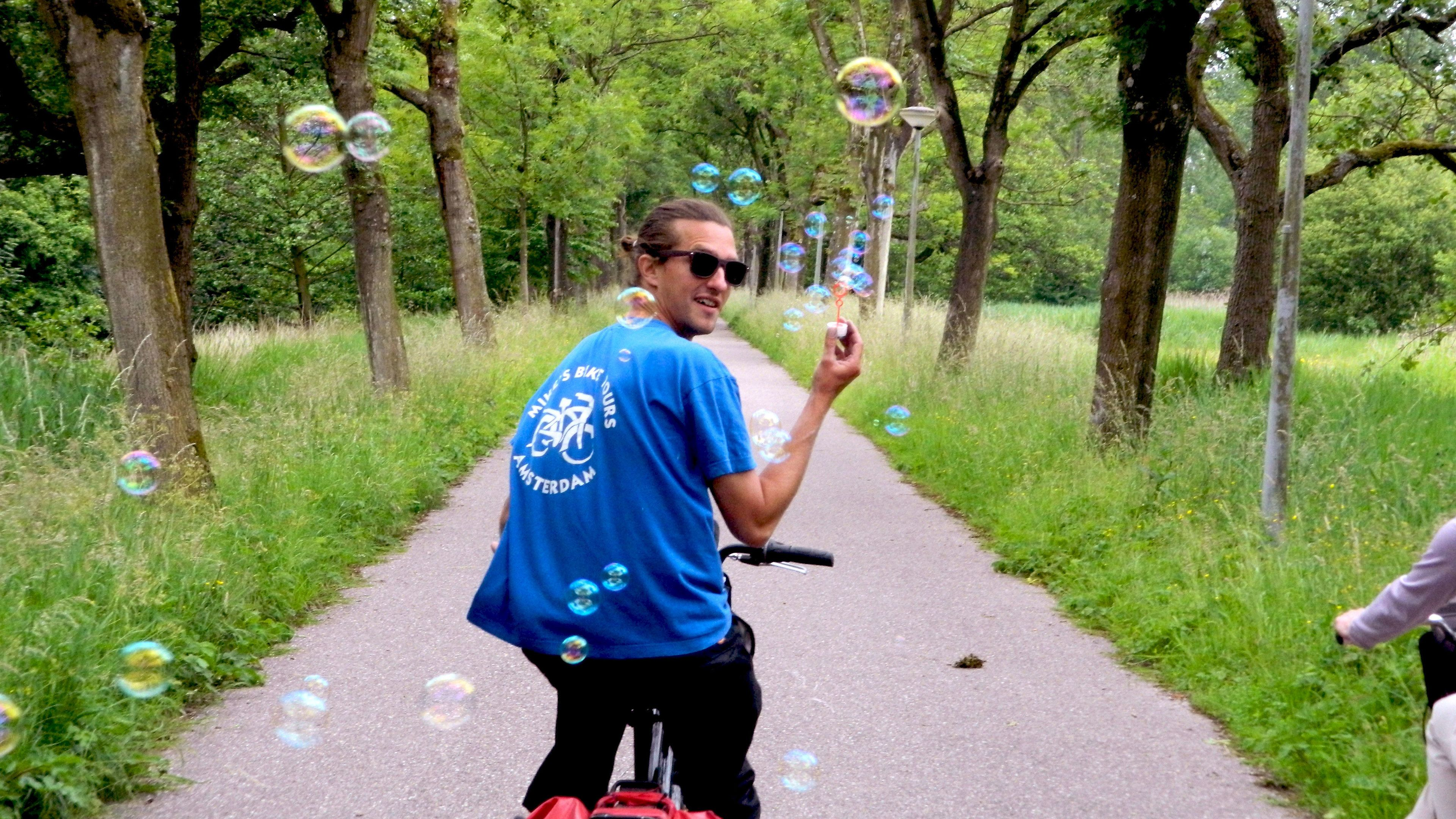 Bicycle rider with bubbles in Amsterdam