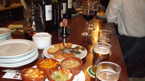 View of the tapas and drinks on the table in Madrid