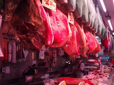 Meat hanging from hooks in a Butchers shop