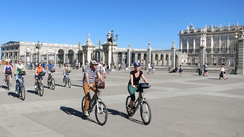 Bicyclists going through the streets of Madrid during the day