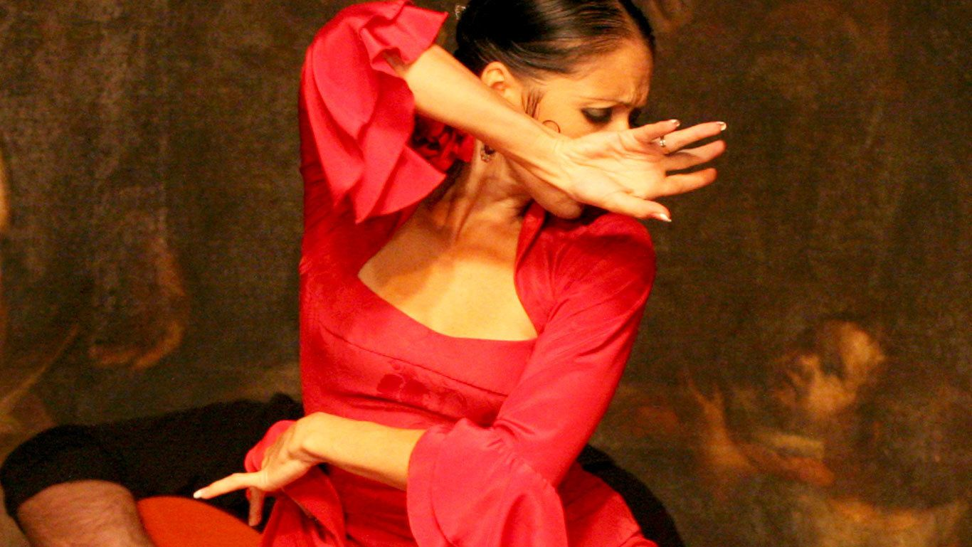 Close up of female performer in mid dance at the Flamenco Show at Corral de la Moreria in Madrid