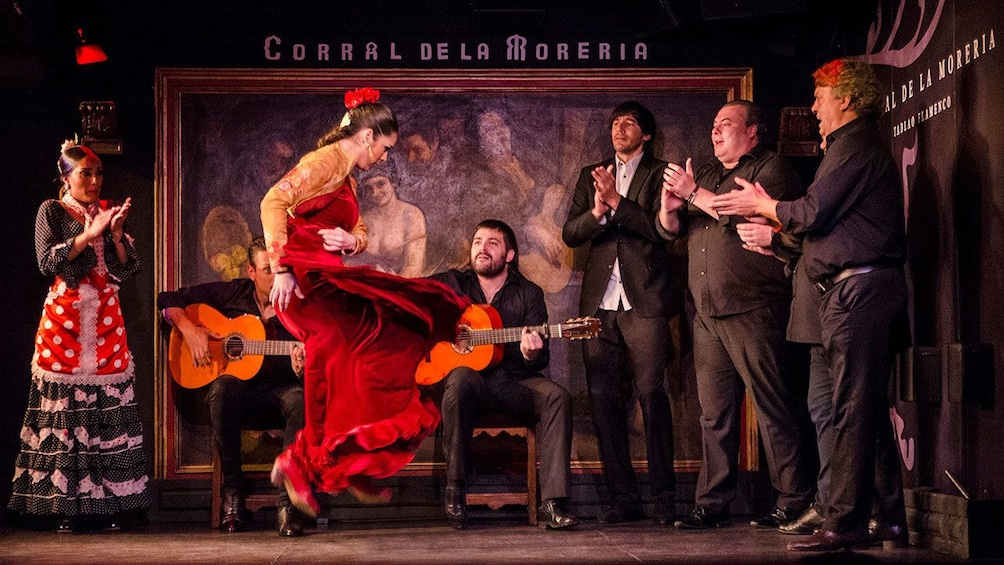Apri foto 1 di 10. Dancer performing while musician plays the guitar during the Flamenco Show at Corral de la Moreria in Madrid