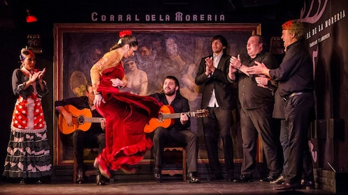 Dancer performing while musician plays the guitar during the Flamenco Show at Corral de la Moreria in Madrid