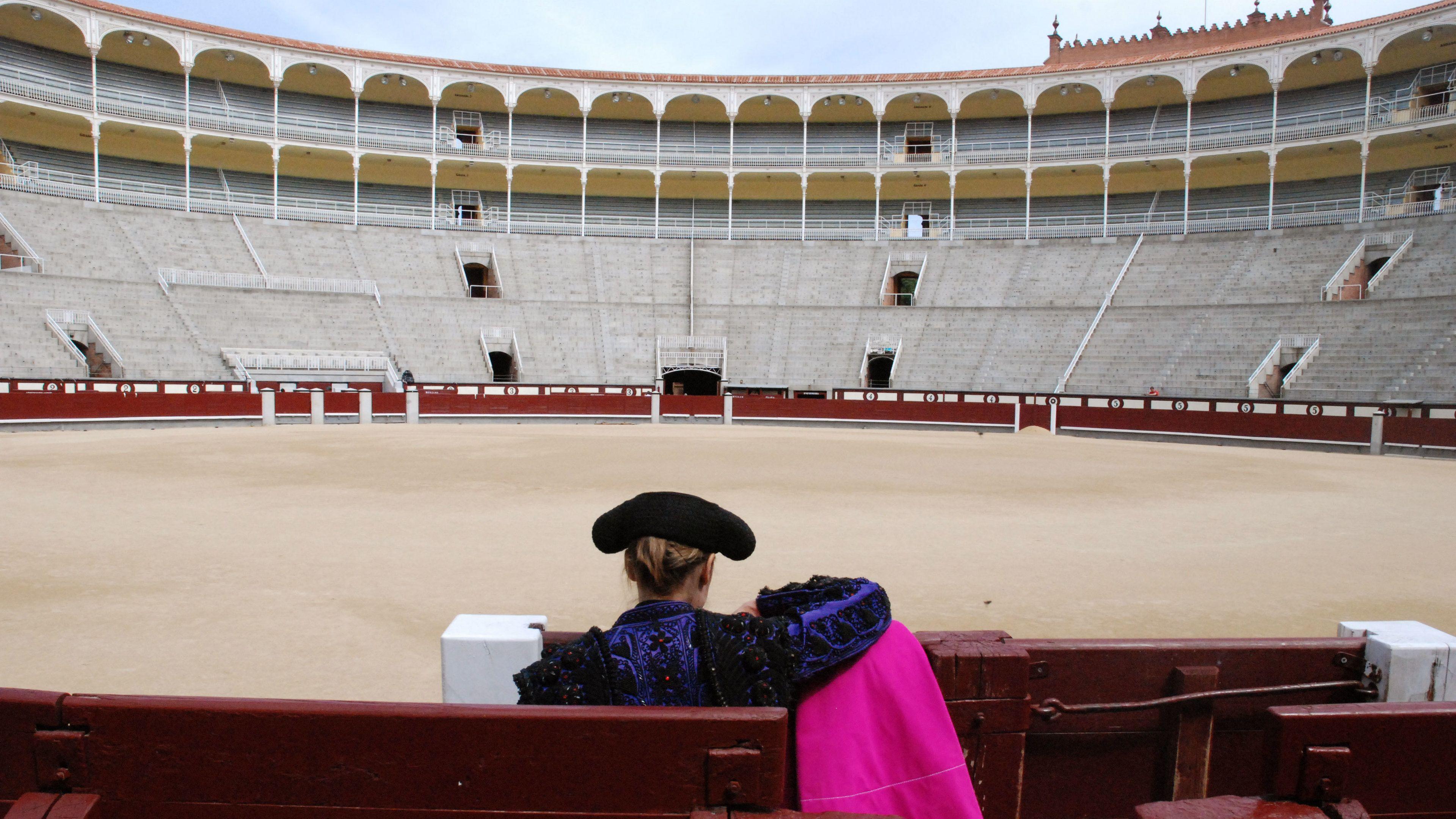 A woman standing inside Las Ventas in Madrid
