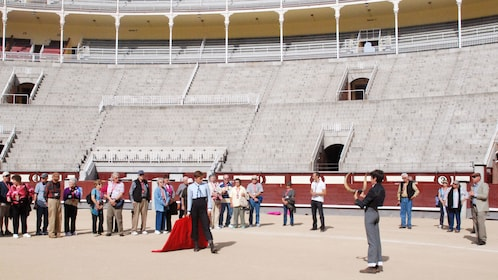 Tourists standing and taking picture inside the Las Ventas in Madrid