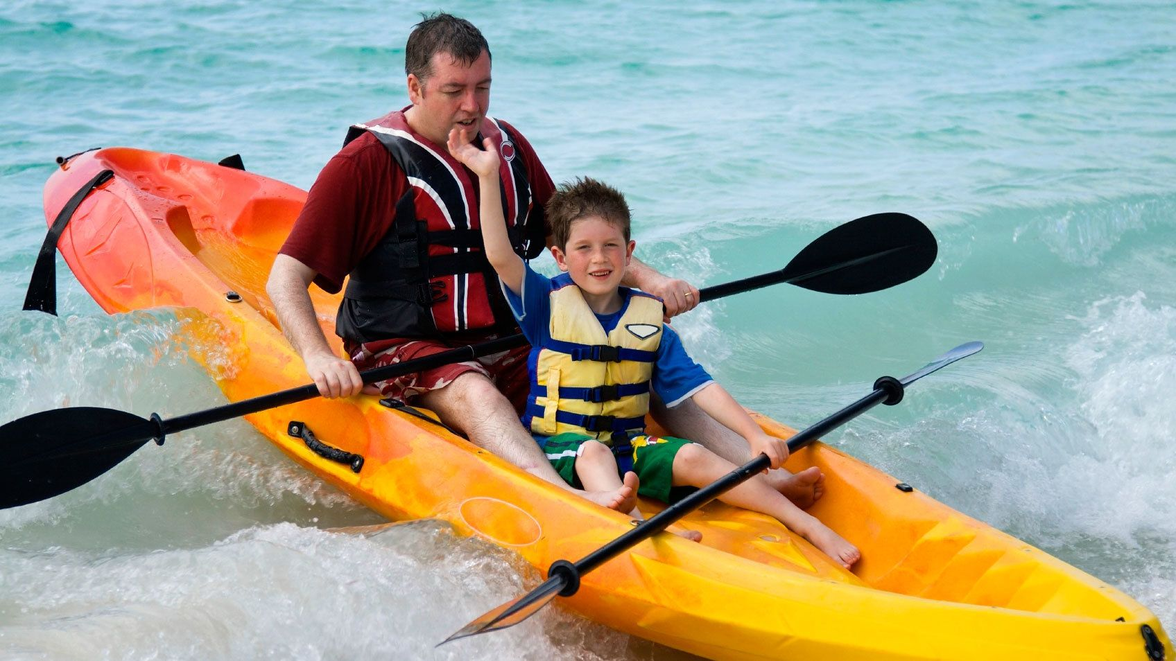 Father and young son in Kayak in Pacific Ocean near San Diego