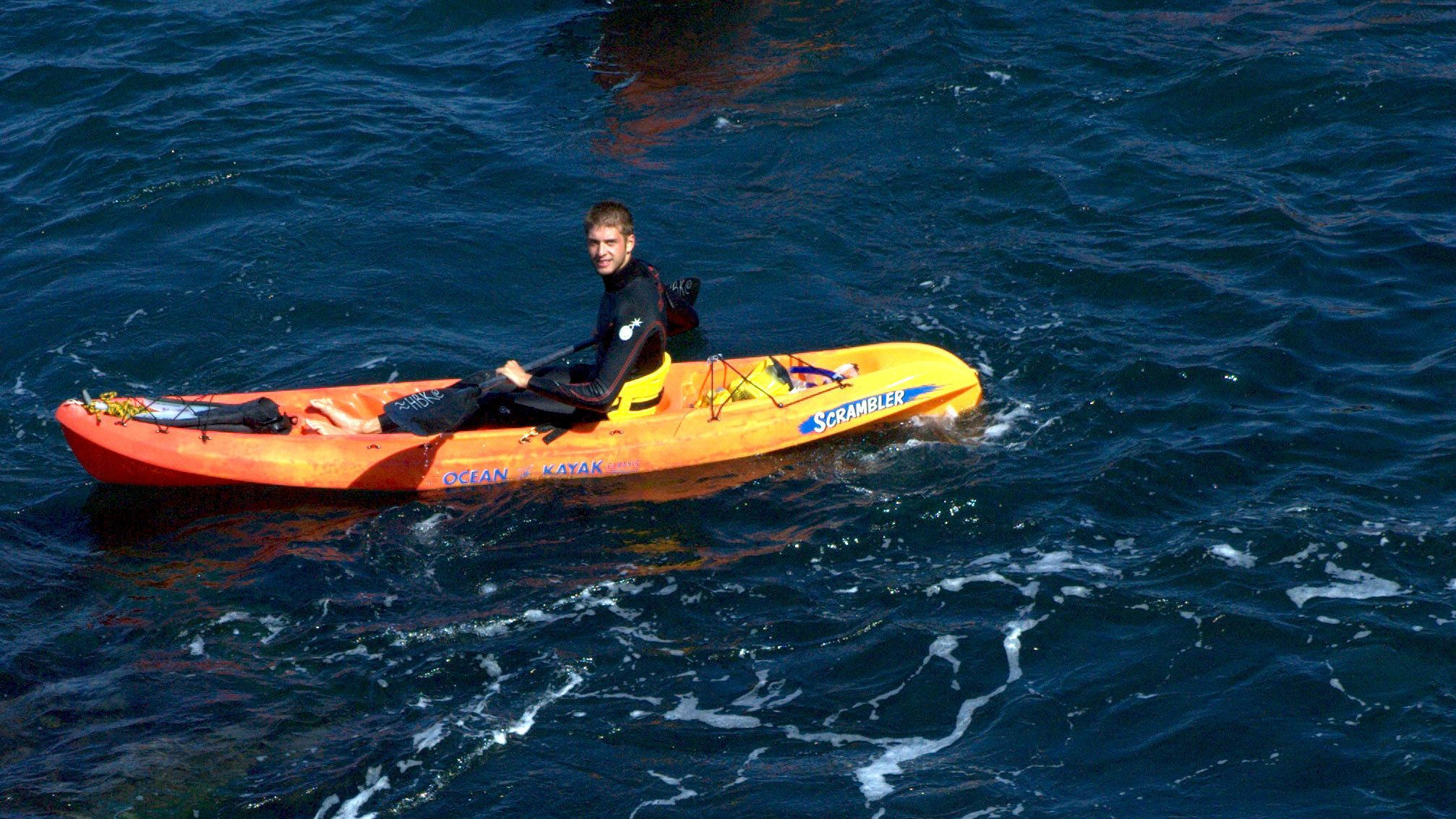 Person in kayak in the Pacific ocean near San Diego