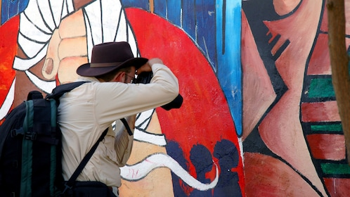 Photographer documenting wall art in Washington DC