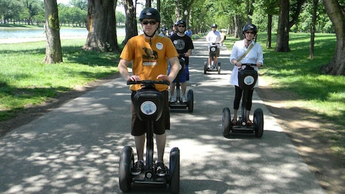 Segway riders following tour on the sidewalk in Washington DC
