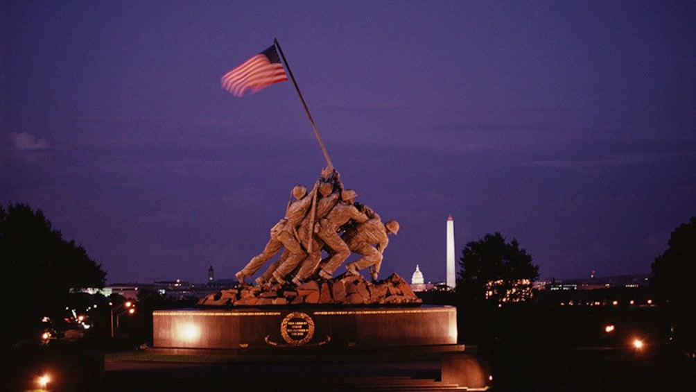 Show item 2 of 8. The Marine Corps Memorial at night in Washington DC