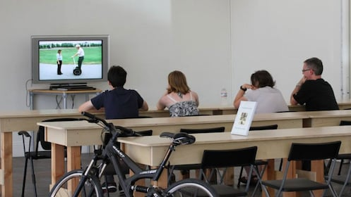 Group watching introduction to segway video in San Diego