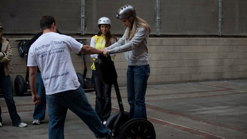 Instructor helping student with her segway in San Diego