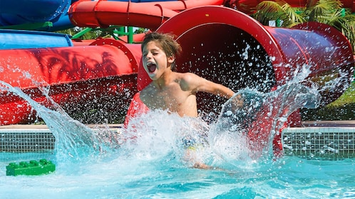 Kids coming out of a water slide