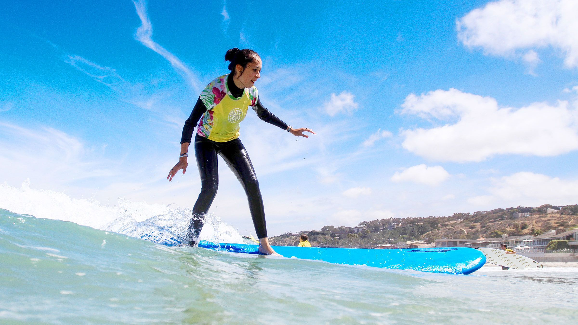 Woman surfing in the water of San Diego