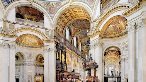 detailed artwork on ceiling and walls inside St. Paul's Cathedral in London