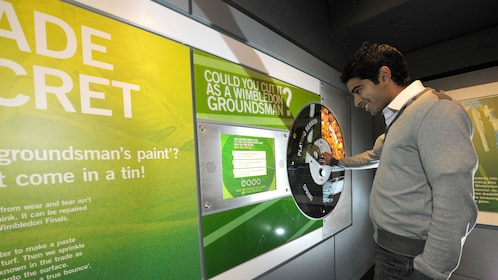 a man takes interactive test at Wimbledon Tennis Museum in London